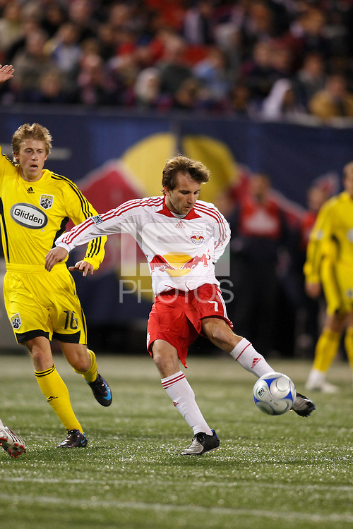 New York Red Bulls forward Mike Magee (7) takes a shot as Columbus Crew midfielder Brian Carroll (16) looks for an offside flag. The New York Red Bulls defeated the Columbus Crew 2-0 during a Major League Soccer match at Giants Stadium in East Rutherford, NJ, on April 5, 2008.