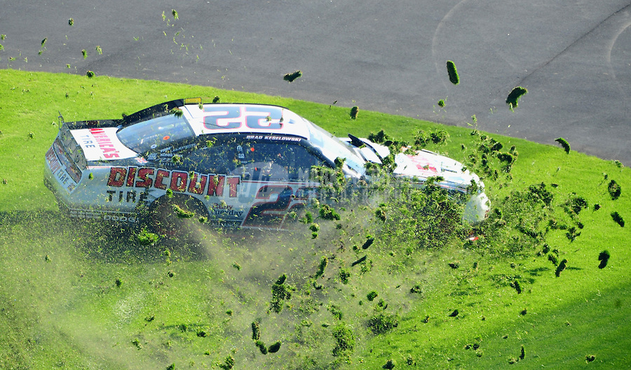 Feb 19, 2011; Daytona Beach, FL, USA; Grass flies as NASCAR Nationwide Series driver Brad Keselowski crashes during the DRIVE4COPD 300 at Daytona International Speedway. Mandatory Credit: Mark J. Rebilas-