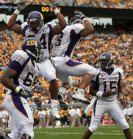 East Carolina offense celebrating a touchdown. The WVU Mountaineers defeated the East Carolina Pirates 35-20 at Mountaineer Field at Milan Puskar Stadium, Morgantown, West Virginia on September 12, 2009.