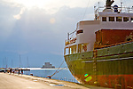 A ship is tied to the dock in the Nafplio harbour, overlooking the Isle of Bourtzi.