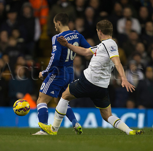 01.01.2015.  London, England. Barclays Premier League. Tottenham versus Chelsea. Chelsea's Eden Hazard is fouled by Tottenham Hotspur's Jan Vertonghen.