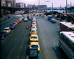 Cars parked next to the river.Hamburg, Germany 1976