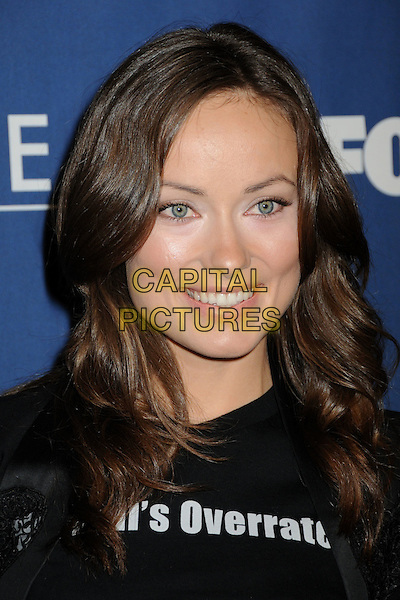 "OLIVIA WILDE.""House"" 100th Episode Party at STK, Los Angeles, California, USA..January 21st, 2009.headshot portrait black normal's overrated .CAP/ADM/BP.©Byron Purvis/AdMedia/Capital Pictures."