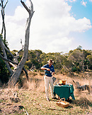 AUSTRALIA, Kangaroo Island, guide Craig Wickham pouring drink from thermos