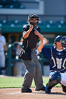 Home plate umpire Jhonatan Biarreta calls a strike during the first game of a doubleheader between the Bradenton Marauders and the Lakeland Flying Tigers on April 11, 2018 at Publix Field at Joker Marchant Stadium in Lakeland, Florida.  Lakeland defeated Bradenton 5-4.  (Mike Janes/Four Seam Images)