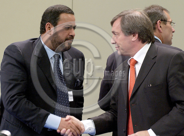 Brussels-Belgium - 09 June 2005---Press conference on the first meeting of the EU-OPEC Energy Dialogue, here: Sheikh Ahmad Fahad Al-Ahmad AL-SABAH (le), President of OPEC and Minister of Energy of Kuwait, shaking hands with Jeannot KRECKE (Krecké) (ri), Minister of Economy and Foreign Trade of Luxembourg and acting President of the EU-Council; in the press room of the HQ of the EC---Photo: Horst Wagner/eup-images