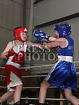 Jamie Muckian, Silverbridge (Blue) and Craig Moore, St. Cianan's (Red) at the Boxing Championships at St. Cianan's Boxing Club, Duleek.<br /> <br /> Photo: Jenny Matthews