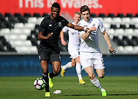 SWANSEA, WALES - MARCH 25: Chidozie Awaziem of Porto is closely marked by Adnan Maric of Swansea City during the Premier League International Cup Semi Final match between Swansea City and Porto at The Liberty Stadium on March 25, 2017 in Swansea, Wales. (Photo by Athena Pictures)