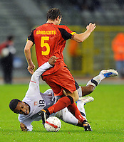 USA's Juan Agudelo (l) and Belgium's Nicolas Lombaerts fight for the ball during the friendly match Belgium vs USA at King Baudoin stadium in Brussels, Belgium on September 06th, 2011.
