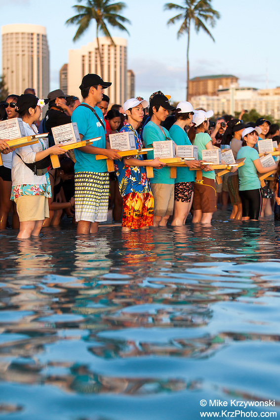 Japanese participants standing in the water holding lanterns at the 15th annual Lantern Floating Ceremony at Ala Moana Beach Park  on Memorial Day