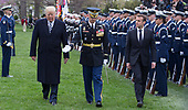 United States President Donald J. Trump and President Emmanuel Macron of France review troops during a state visit to The White House in Washington, DC, April 24, 2018. Credit: Chris Kleponis / Pool via CNP
