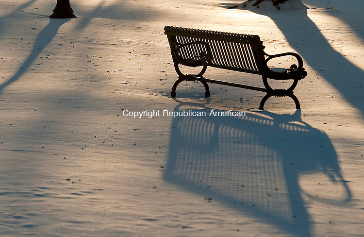 WINSTED, CT-010414JS12- The late afternoon shadows are seen on the newly fallen snow near a bench at East End Park in Winsted on Saturday afternoon. <br />  Jim Shannon Republican-American