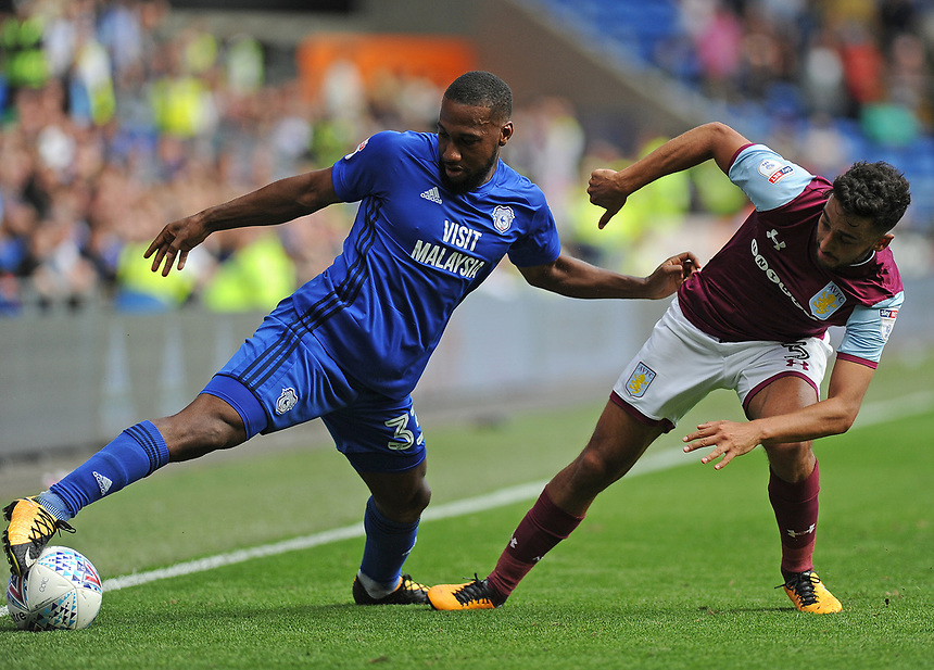 Cardiff City's Junior Hoilett vies for possession with Aston Villa's Neil Taylor<br /> <br /> Photographer Ashley Crowden/CameraSport<br /> <br /> The EFL Sky Bet Championship - Cardiff City v Aston Villa - Saturday August 12th 2017 - Cardiff City Stadium - Cardiff<br /> <br /> World Copyright &copy; 2017 CameraSport. All rights reserved. 43 Linden Ave. Countesthorpe. Leicester. England. LE8 5PG - Tel: +44 (0) 116 277 4147 - admin@camerasport.com - www.camerasport.com