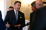 Nevada Gov. Brian Sandoval talks with cabinet and staff members during a holiday lunch at the Governor's Mansion in Carson City, on Wednesday, Dec. 19, 2018. (Cathleen Allison/Las Vegas Review-Journal)