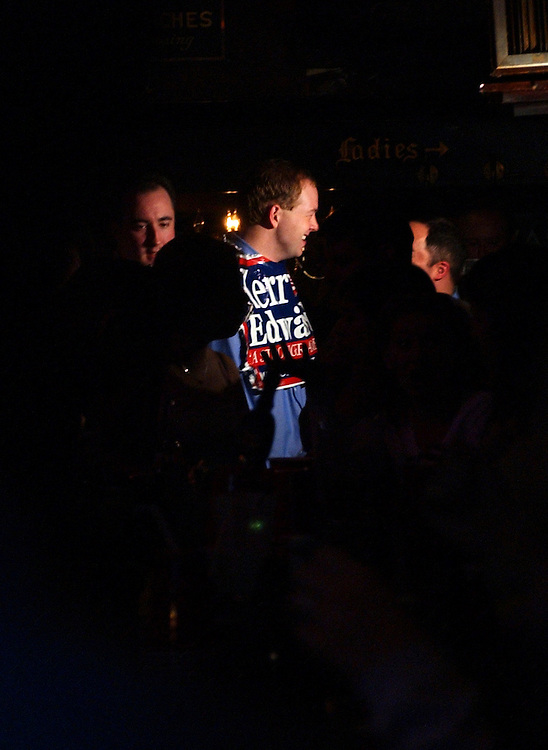Alexander Tumeski sports a Kerry/Edwards sign during election night 2004 in Hawk N' Dove on Capitol Hill.