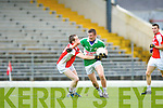 Jerh Sheehan Kilcummin/Rathmore tackles Chris Davies Legion during the County Champship final in Fitzgerald Stadium last Thursday evening