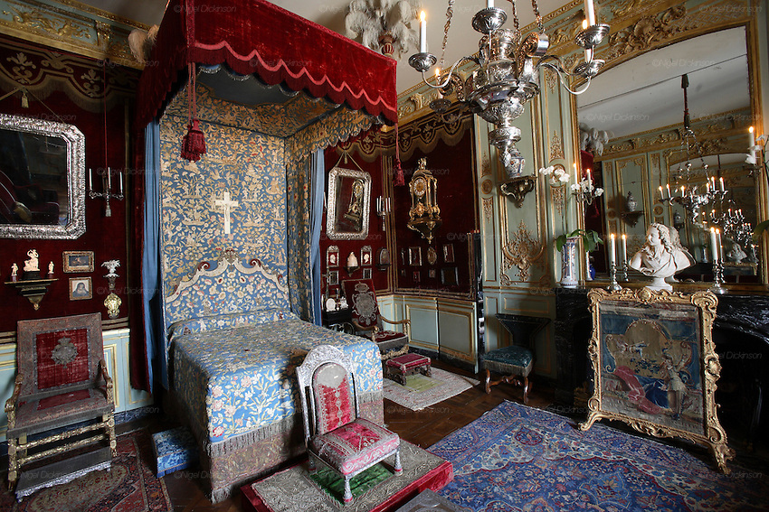 "France's ostentatious interior decorator and landscape architect, self-made man Jacques Garcia in his Norman country retreat 'le Chateau du Champ de la Bataille. He is responsible for the Parisian Ladurée teahouse and Hotel  Costes. His client list includes the Sultan of Brunei. He bought the chateau, one hours drive from Paris, at le Neubourg in Normandie, twenty years ago and faced with one of the great masterpieces of French Architecture, his self appointed task was to make it more sublime. Hardly touching the facade, he re-designed the interiors to be lavish interpretations of Baroque, recalling Louis XIV and Marie Antoinette. The stylish gardens contain Roma style temples, an amphitheatre and fountains.  The chateau, open to the public, attracts 30,000 visitors per year. In 2007, with the addition of  restaurant and hotel rooms, the project will be finished.///Chateau du Champ de la Bataille interior: ""Chambre de Parade"""
