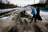 Two women push a baby pram across train tracks in Dzherjinsk, one of the world's most polluted cities in Russia. The city, named after founding KGB chief Felix Dzherjinski, at the heart of the former Soviet Union's chemical weapons production. It is 400 KM east of Moscow and is home to a population of 300,000.