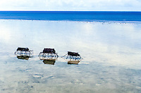 Maluku, North Maluku, Halmahera. Small bamboo shelters on a beach close to Halmahera (from helicopter)