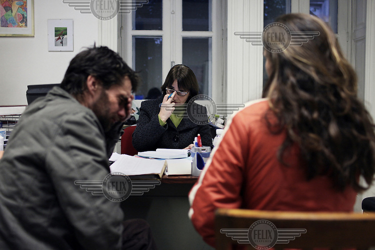 A doctor with patients during a counseling session at the Cedofeita treatment centre for drug addiction in Porto. In 2000, the government passed a law that changed possession of drugs from a judicial issue to a matter of public and community health. According to the Institute for Drugs and Drug Addiction, a branch of Portugal's Ministry of Health, the number of heroin users has dropped from 100,000 in 2000, to 55,000 users in 2008.