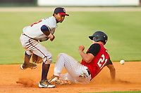 Rome Braves shortstop Elmer Reyes (7) waits for the throw as Mark Haddow (21) of the Kannapolis Intimidators steals second base at CMC-Northeast Stadium on August 5, 2012 in Kannapolis, North Carolina.  The Intimidators defeated the Braves 9-1.  (Brian Westerholt/Four Seam Images)