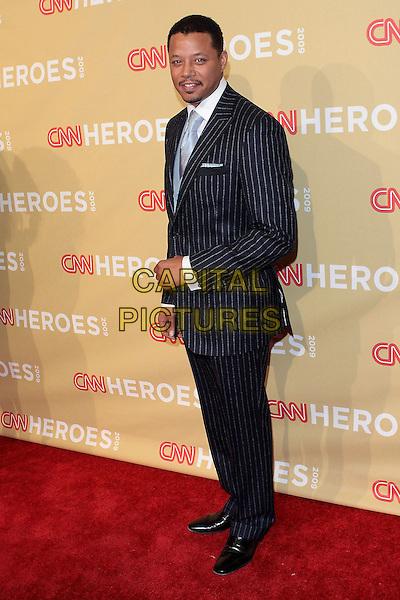 TERRENCE HOWARD.CNN Heroes: An All Star Tribute 2009  held at Kodak Theatre, Hollywood, California, USA..November 21st 2009 .full length black suit blue pinstripe .CAP/ADM/TC.©T. Conrad/AdMedia/Capital Pictures.