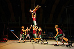 Florida State University's Flying High Circus is an extra-curricular activity for students. Every summer the circus moves to Pine Mountain, Georgia to Callaway Gardens, where the FSU students perform for crowds under a Big Top six times a week. ..Lynn Jenkins is catapulted and caught by a fellow performer during a performance July 28, 2012.