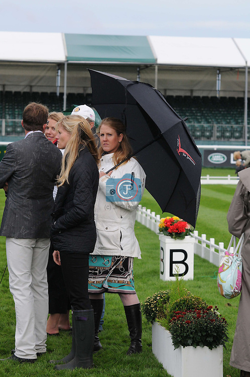 Allison Springer (USA) holding a Point Two Air Jacket umbrella at the 1st Veterinary Inspection at the 2012 Land Rover Burghley Horse Trials in Stamford, Lincolnshire, England, UK.