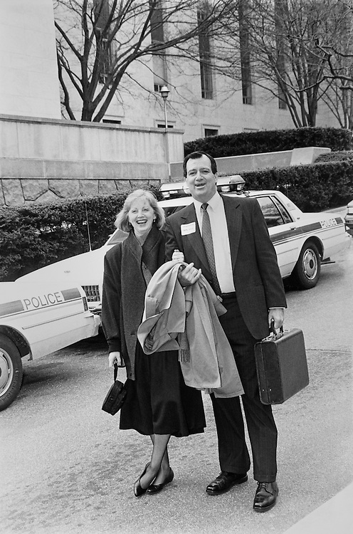 Rep. Terry Lee Bruce, D-Ill., House of Representatives Member, and wife Charlotte Bruce leaving for democratic retreat from horseshoe area, Rayburn. March 8, 1991 (Photo by Maureen Keating/CQ Roll Call)