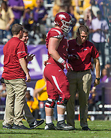 NWA Democrat-Gazette/BEN GOFF @NWABENGOFF<br /> Trainers evaluate Hjalte Froholdt, Arkansas left guard, in the first quarter against LSU Saturday, Nov. 11, 2017 at Tiger Stadium in Baton Rouge, La.