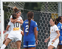 Western New York Flash midfielder Carli Lloyd (10) celebrates her goal with teammates.  In a National Women's Soccer League (NWSL) match, Boston Breakers (blue) tied Western New York Flash (white), 2-2, at Dilboy Stadium on August 3, 2013.