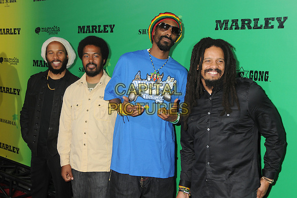 "Ziggy Marley, Robbie Marley, Snoop Dogg (Calvin Cordozar Broadus, Jr.), Rohan Marley.""Marley"" Los Angeles Premiere held at Arclight Cinemas, Hollywood, California, USA..April 17th, 2012.half length blue sunglasses shades blueline clothing t-shirt print yellow green red hat beard facial hair black beige hands.CAP/ADM/BP.©Byron Purvis/AdMedia/Capital Pictures."