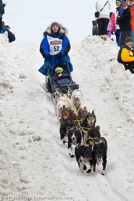 Tore Albrigtsen and team run past spectators on the bike/ski trail with an Iditarider in the basket during the Anchorage, Alaska ceremonial start on Saturday, March 5, 2016 Iditarod Race. Photo by O'Hara Shipe/SchultzPhoto.com