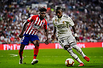 Vinicius Junior of Real Madrid (R) in action against Thomas Teye of Atletico de Madrid (L) during their La Liga  2018-19 match between Real Madrid CF and Atletico de Madrid at Santiago Bernabeu on September 29 2018 in Madrid, Spain. Photo by Diego Souto / Power Sport Images