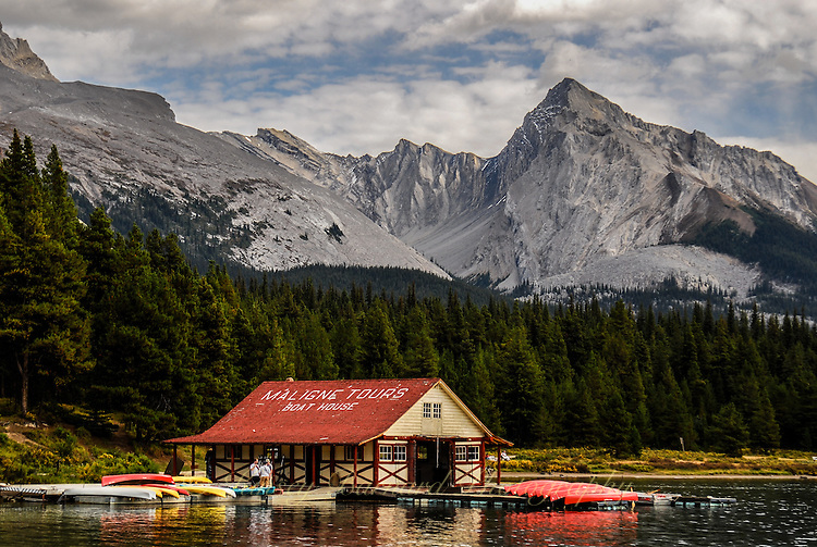 Beautiful Maligne Lake at Jasper National Park Alberta Canada. Blue skies, white clouds and deep blue water