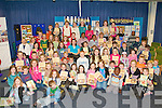 QUEST SEEKERS: Some of the over 120 children who took part in the Kerry Library summer reading challenge who received their Quest Seekers certificates from Executive Librarian Ann Ferguson at the Kerry Library on Saturday. ?