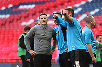 Graham Alexander manager of Salford City staff points out Salford City famous owners above after the AFC Fylde vs Salford City, Vanarama National League Play-Off Final Football at Wembley Stadium on 11th May 2019