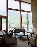 The glazed walls of the sitting room make the most of the spectacular Arizona landscape that surrounds the property
