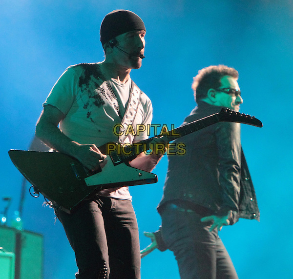 The Edge and Bono of U2 .performs on the bands 360? Tour at Lincoln Financial Field in Philadelphia, Pennsylvania, USA, July 14th, 2011..music concert gig live on stage half length  glasses black jacket sunglasses black jacket  .CAP/RKE/EML.©EML/RockinExposures/Capital Pictures.