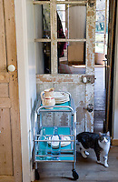 The sliding door to the kitchen has been left unrestored and its history can be seen in the many layers of exposed paint