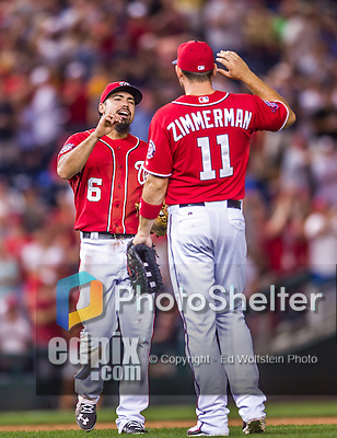 22 August 2015: Washington Nationals infielder Anthony Rendon greets Ryan Zimmerman after nabbing a line drive for the final out of the game against the Milwaukee Brewers at Nationals Park in Washington, DC. The Nationals defeated the Brewers 6-1 in the second game of their 3-game weekend series. Mandatory Credit: Ed Wolfstein Photo *** RAW (NEF) Image File Available ***