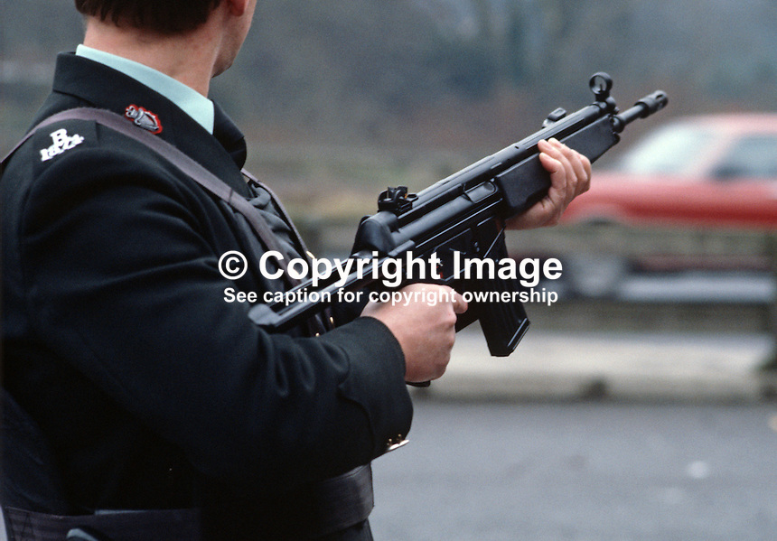 A RUC officer displays the Heckler & Koch HK33 rifle which has been issued to the N Ireland police force. January 1985. 19850004c..Copyright Image from Victor Patterson, 54 Dorchester Park, Belfast, UK, BT9 6RJ..Tel: +44 28 9066 1296.Mob: +44 7802 353836.Voicemail +44 20 8816 7153.Skype: victorpattersonbelfast.Email: victorpatterson@mac.com.Email: victorpatterson@ireland.com (back-up)..IMPORTANT: If you wish to use this image or any other of my images please go to www.victorpatterson.com and click on the Terms & Conditions. Then contact me by email or phone with the reference number(s) of the image(s) concerned.