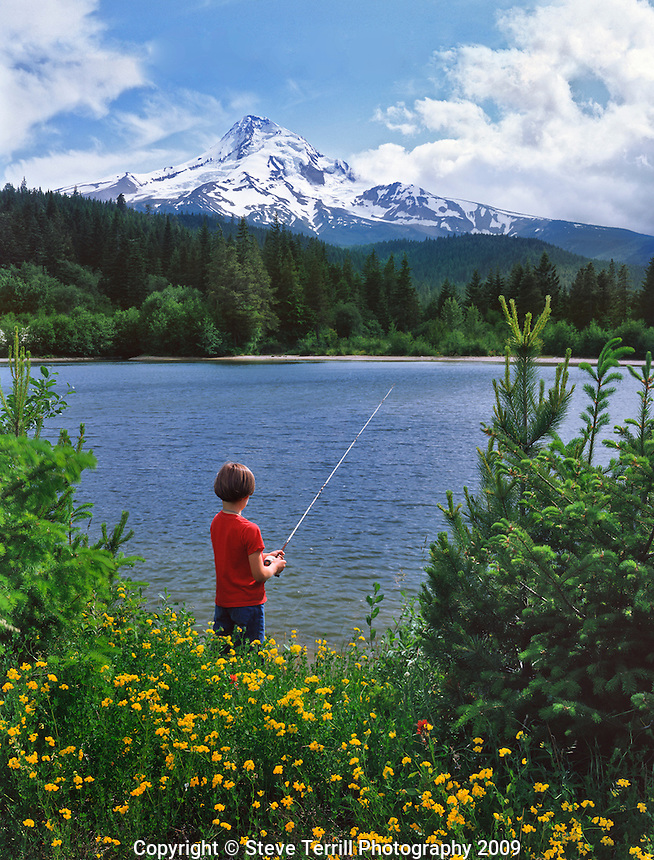 Child fishing in First Lake in Mt Hood National Foresst Oregon