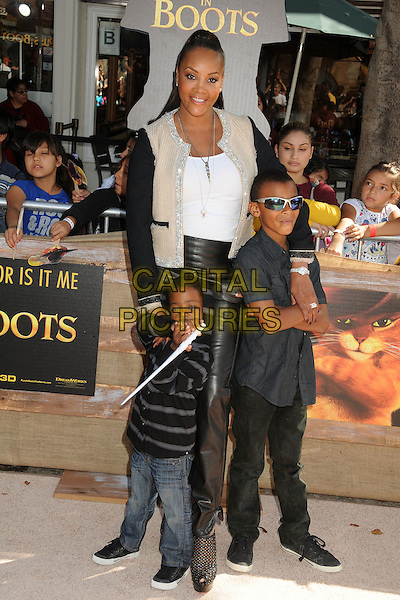 Vivica A. Fox & guests.The L.A. Premiere of 'Puss in Boots' held at The Regency Village Theatre in Westwood, California, USA..October 23rd, 2011.full length black leather trousers jacket white top beige kids.CAP/ADM/BP.©Byron Purvis/AdMedia/Capital Pictures.
