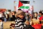 A Palestinian bedouin boy poses for a photo during a rally marking the 41st anniversary of Land Day, in Deir el-Balah, Central Gaza Strip, on March 31, 2017.  Land Day marks the killing of six Arab Israelis during 1976 demonstrations against Israeli confiscations of Arab land. Photo by Ashraf Amra