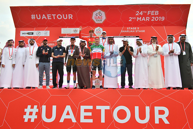 Stage winner and jersey leaders on the podium at the end of Stage 5 of the 2019 UAE Tour, running 181km form Sharjah to Khor Fakkan, Dubai, United Arab Emirates. 28th February 2019.<br /> Picture: LaPresse/Massimo Paolone | Cyclefile<br /> <br /> <br /> All photos usage must carry mandatory copyright credit (© Cyclefile | LaPresse/Massimo Paolone)