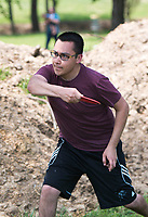 NWA Democrat-Gazette/CHARLIE KAIJO Jose Sifuentes of Centerton plays disk golf, Monday, May 14, 2018 at McKissic Springs Station park in Centerton. <br />