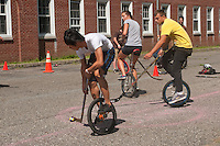 Governor's  Island, NY -  4 September 2010 Unicyclists play hockey during the New York City Unicycle Festival on Governor's Island.