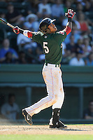 Shortstop Deiner Lopez (5) of the Greenville Drive bats in a game against the Charleston RiverDogs on Sunday, June 28, 2015, at Fluor Field at the West End in Greenville, South Carolina. Charleston won, 12-9. (Tom Priddy/Four Seam Images)