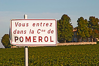 "A sign saying  ""Vous entrez dans la commune de Pomerol"" - you are entering the commune of Pomerol, Bordeaux"